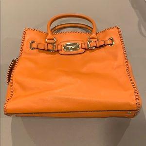 Michael Kors Orange and Gold Handbag